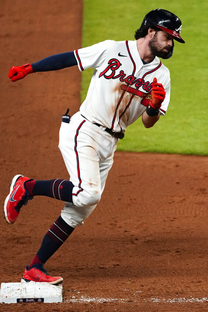 Atlanta Braves' Dansby Swanson rounds third base after hitting a home run during the sixth inning of the team's baseball game against the Pittsburgh Pirates on Thursday, May 20, 2021, in Atlanta. (AP Photo/John Bazemore)