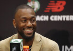Newly acquired Boston Celtics guard Kemba Walker smiles during a news conference at the Celtics' basketball practice facility, Wednesday, July 17, 2019, in Boston. (AP Photo/Elise Amendola)
