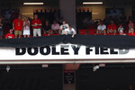 A sign is unveiled during a ceremony at Sanford Stadium before Georgia's NCAA college football game against Murray State to name the field in honor of longtime head football coach and athletic director Vince Dooley, Saturday, Sept. 7, 2019, in Athens, Ga. (AP Photo/John Bazemore)