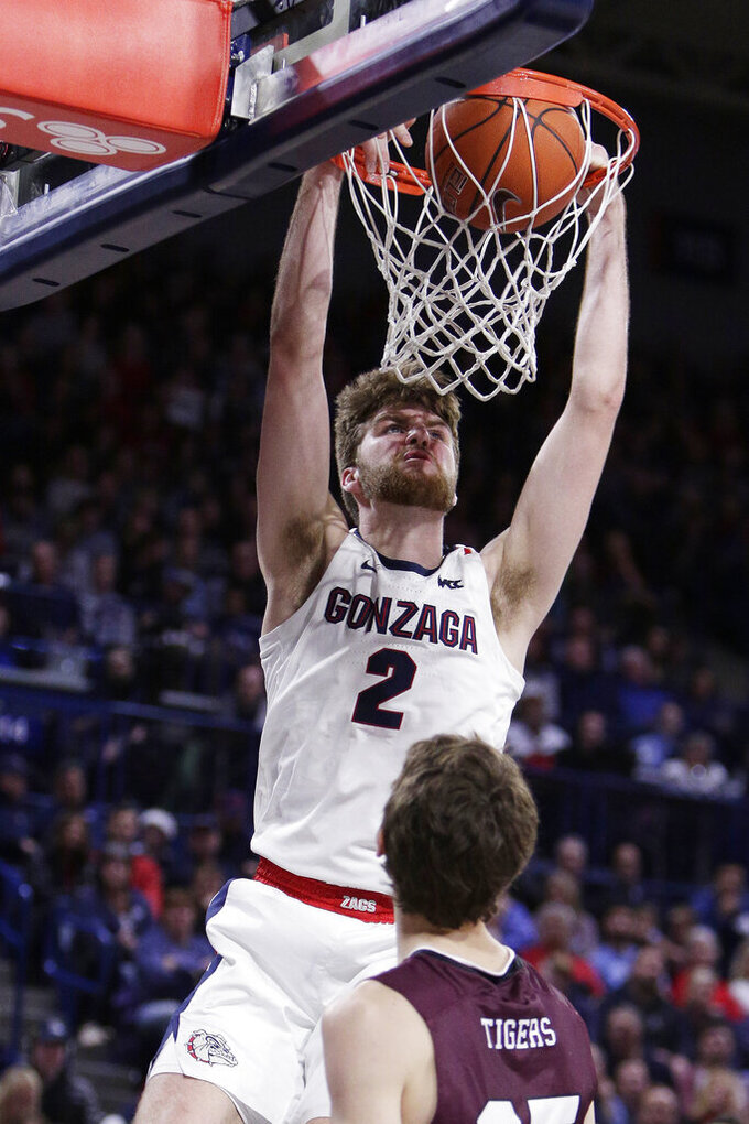 Gonzaga forward Drew Timme, left, dunks in front of Texas Southern guard Jordan Andrews during the second half of an NCAA college basketball game in Spokane, Wash., Wednesday, Dec. 4, 2019. Gonzaga won 101-62. (AP Photo/Young Kwak)