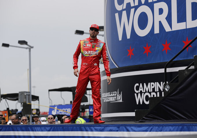 Kyle Busch walks on the stage during drivers introduction before the NASCAR Cup Series auto race at Chicagoland Speedway in Joliet, Ill., Sunday, June 30, 2019. (AP Photo/Nam Y. Huh)