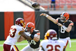 Cleveland Browns quarterback Baker Mayfield (6) throws during the first half of an NFL football game against the Washington Football Team, Sunday, Sept. 27, 2020, in Cleveland. (AP Photo/David Richard)