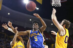 UCLA's Chris Smith (5) loses the ball while driving between Arizona State's Alonzo Verge (11) and Mickey Mitchell (00) during the first half of an NCAA college basketball game Thursday, Feb. 6, 2020, in Tempe, Ariz. (AP Photo/Darryl Webb)