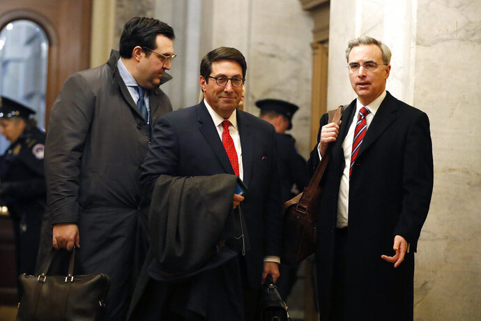 President Donald Trump's personal attorney Jay Sekulow, center, stands with his son, Jordan Sekulow, left, and White House Counsel Pat Cipollone, while arriving at the Capitol in Washington during the impeachment trial of President Donald Trump on charges of abuse of power and obstruction of Congress, Saturday, Jan. 25, 2020. (AP Photo/Julio Cortez)