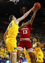 Michigan center Jon Teske (15) blocks a Indiana forward Juwan Morgan (13) shot in the first half of an NCAA college basketball game in Ann Arbor, Mich., Sunday, Jan. 6, 2019. (AP Photo/Paul Sancya)