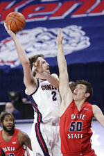 Gonzaga forward Drew Timme (2) shoots over Dixie State forward Jarod Greene (50) during the first half of an NCAA college basketball game in Spokane, Wash., Tuesday, Dec. 29, 2020. (AP Photo/Young Kwak)
