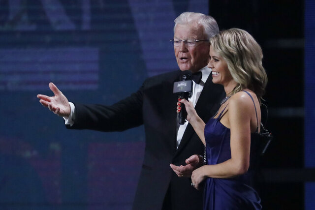 Team owner Joe Gibbs, left, speaks after being given the Bill France Award of Excellence at the NASCAR Cup Series Awards on Thursday, Dec. 5, 2019, in Nashville, Tenn. (AP Photo/Mark Humphrey)