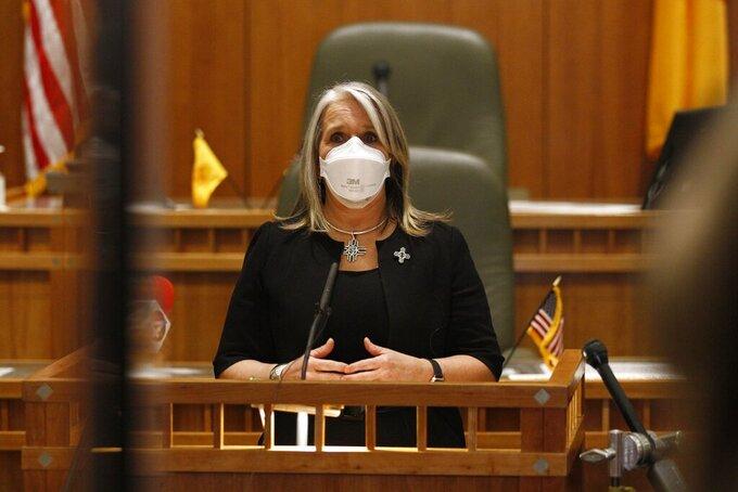 Democratic Gov. Michelle Lujan Grisham speaks following the end of New Mexico's annual legislative session on Saturday, March 20, 2021, in Santa Fe, New Mexico. (AP Photo/Cedar Attanasio)