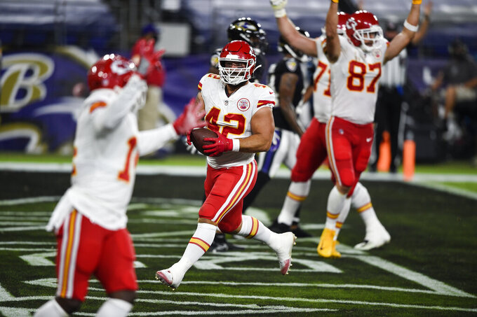 Kansas City Chiefs running back Anthony Sherman (42) and teammates celebrate his touchdown after his pass reception during the first half of an NFL football game against the Baltimore Ravens, Monday, Sept. 28, 2020, in Baltimore. (AP Photo/Gail Burton)