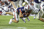 Auburn quarterback Bo Nix (10) dives for extra yardage as Akron linebacker Bubba Arslanian (27) tackles him during the first half of an NCAA college football game Saturday, Sept. 4, 2021, in Auburn, Ala. (AP Photo/Butch Dill)