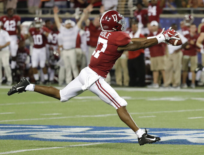 FILE - In this Sept. 1, 2018, file photo, Alabama wide receiver Jaylen Waddle makes a fingertip catch for a 49-yard reception against Louisville during the first half of an NCAA college football game, in Orlando, Fla. Waddle is the Southeastern Conference's top freshman, and it's not really even close. Waddle has 21 catches for 457 yards and three touchdowns and has been equally valuable as a punt returner, averaging 16 yards and taking one back for a score. (AP Photo/John Raoux, File)
