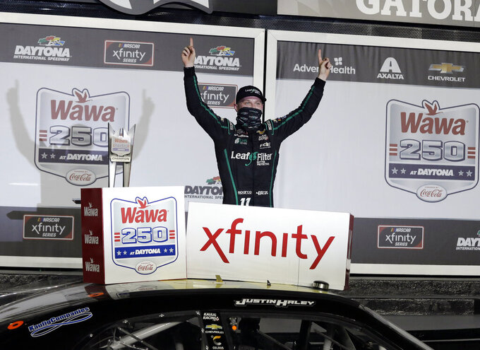 "FILE - In this Aug. 28, 2020 file photo, Justin Haley celebrates in Victory Lane after winning a NASCAR Xfinity auto race at Daytona International Speedway  in Daytona Beach, Fla.  The Xfinity Series prides itself as the ""Names Are Made Here"" division of NASCAR and it fits this year's playoff class well.    (AP Photo/Terry Renna, File)"
