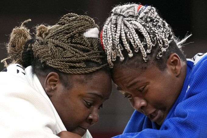 Idalys Ortiz, of Cuba, left, and Romane Dicko, of France ,compete during their women's +78kg semifinal judo match at the 2020 Summer Olympics, Friday, July 30, 2021, in Tokyo, Japan. (AP Photo/Vincent Thian)