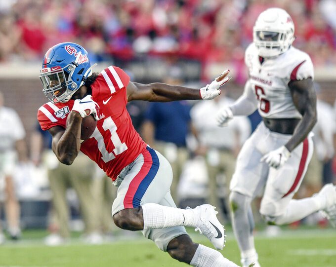 Mississippi wide receiver Dontario Drummond (11) catches a pass against Arkansas during the first half of an NCAA college football game, Saturday, Sept. 7, 2019, in Oxford, Miss. (Bruce Newman/The Oxford Eagle via AP)