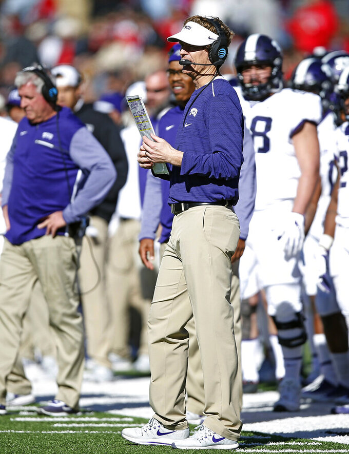 FILE - In this Saturday, Nov. 18, 2017, file photo, TCU offensive coordinator Sonny Cumbie waits for the time out during the second half of the NCAA college football game against Texas Tech, in Lubbock, Texas. In a move announced Monday, Dec. 21, 2020, former Texas Tech quarterback and assistant coach Cumbie is returning to the Red Raiders as their new offensive coordinator after the last seven seasons on TCU's staff. (AP Photo/Brad Tollefson, File)