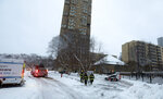 Minneapolis firefighters leave after a deadly fire at a high-rise apartment building, center in background, Wednesday, Nov. 27, 2019, in Minneapolis. (David Joles/Star Tribune via AP)