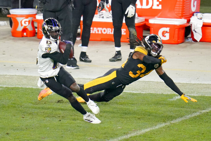 Baltimore Ravens wide receiver Marquise Brown (15) makes a catch in front of Pittsburgh Steelers strong safety Terrell Edmunds (34) and gets away to score a touchdown in the second half during an NFL football game, Wednesday, Dec. 2, 2020, in Pittsburgh. The Steelers won 19-14. (AP Photo/Gene J. Puskar)