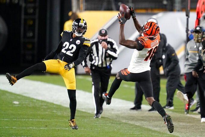 Cincinnati Bengals wide receiver A.J. Green (18) comes down the ball with Pittsburgh Steelers cornerback Steven Nelson (22) defending during the second half of an NFL football game, Sunday, Nov. 15, 2020, in Pittsburgh. (AP Photo/Keith Srakocic)
