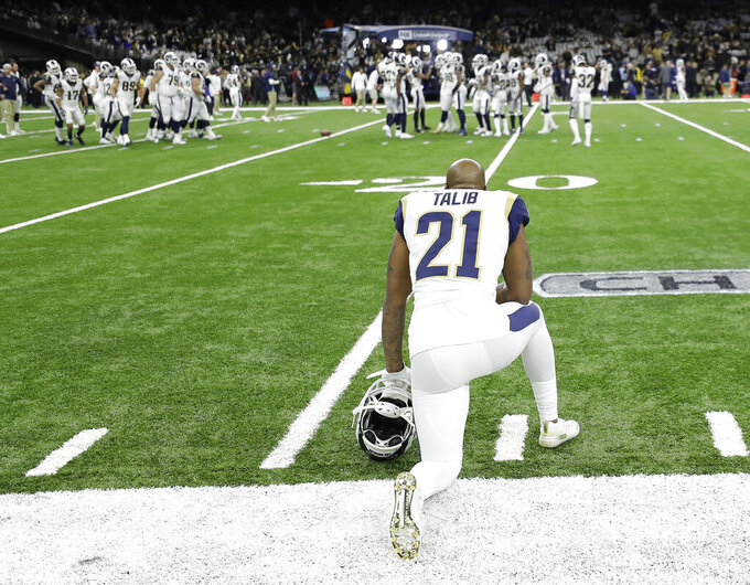 Los Angeles Rams' Aqib Talib watches as players warm up before the NFL football NFC championship game against the New Orleans Saints Sunday, Jan. 20, 2019, in New Orleans. (AP Photo/David J. Phillip)
