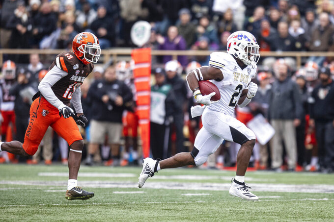 Western Michigan running back LeVante Bellamy (2) breaks out for a 36-yard touchdown run against Bowling Green  during the second quarter of an NCAA college football game in Kalamazoo, Mich., on Saturday, Oct. 26, 2019. (Joel Bissell/Kalamazoo Gazette via AP)
