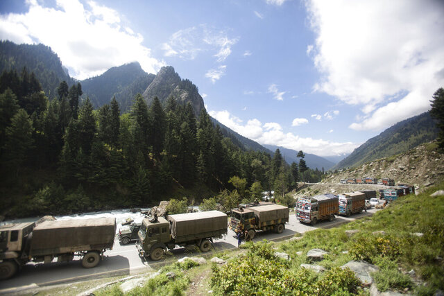 """An Indian army convoy moves on the Srinagar- Ladakh highway at Gagangeer, northeast of Srinagar, Indian-controlled Kashmir, Tuesday, Sept. 1, 2020. India said Monday its soldiers thwarted """"provocative"""" movements by China's military near a disputed border in the Ladakh region months into the rival nations' deadliest standoff in decades. China's military said it was taking """"necessary actions in response,"""
