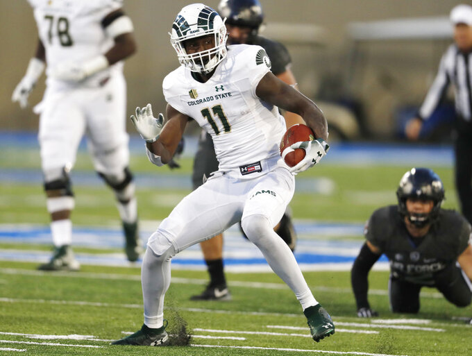 Colorado State wide receiver Preston Williams, front, heads downfield after pulling in a pass in front of Air Force defensive back Jeremy Fejedelem in the second half of an NCAA college football game Thursday, Nov. 22, 2018, at Air Force Academy, Colo. (AP Photo/David Zalubowski)