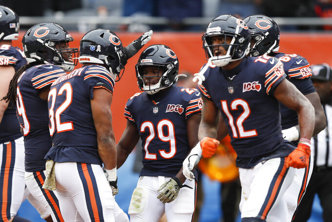 Chicago Bears running back Tarik Cohen (29) celebrates his 9-yard touchdown reception against the Detroit Lions during the second half of an NFL football game in Chicago, Sunday, Nov. 10, 2019. (AP Photo/Charlie Neibergall)