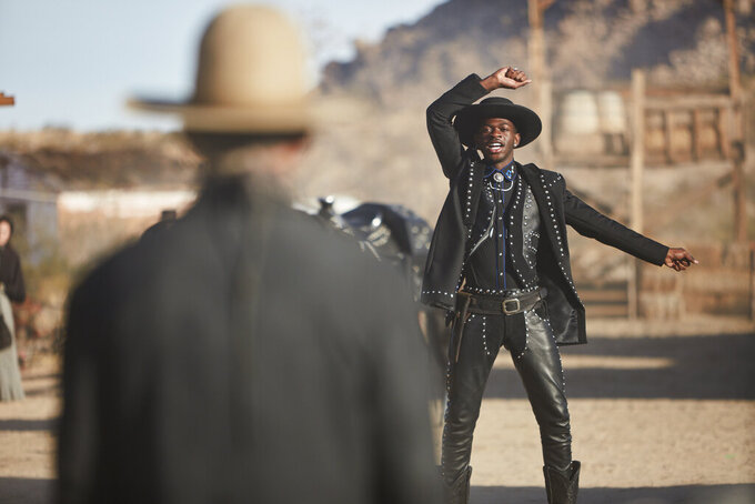 """This undated photo provided by Doritos shows Lil Nas X, right, and Sam Elliott in a scene from the company's 2020 Super Bowl NFL football spot. The snack chip is betting people will connect with """"Old Town Road,"""" the smash hit of the summer by Lil Nas X.(Doritos via AP)"""