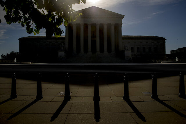 In this May 4, 2020, photo, rhe Supreme Court in Washington. The Supreme Court's second day of arguments by phone is devoted to a new version of a case it decided seven years ago involving federal money to fight AIDS around the world. (AP Photo/Andrew Harnik)