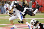 SMU tight end Kylen Granson (83) is tackled by Houston safety Gervarrius Owens, top, and safety Amaud Willis-Dalton, right, during the first half of an NCAA college football game Thursday, Oct. 24, 2019, in Houston. (AP Photo/Michael Wyke)