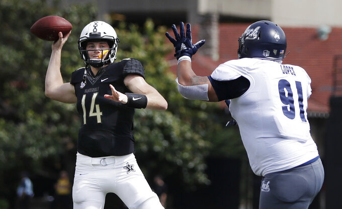 Vanderbilt quarterback Kyle Shurmur (14) passes as he is pressured by Nevada defensive end Adam Lopez (91) in the first half of an NCAA college football game Saturday, Sept. 8, 2018, in Nashville, Tenn. (AP Photo/Mark Humphrey)