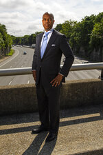 Tennessee State Rep. Harold Love, Jr. stands on an overpass over I-40, Monday, July, 19, 2021, on the north side of Nashville, Tenn. Love Jr.'s father, a Nashville city councilman, was forced to sell his family home near this spot to make way for the highway, but put up a fight in the 1960s against the rerouting of Interstate 40 because he believed it would stifle and isolate Nashville's Black community. Love Jr. is now part of a group pushing to build a cap across the highway that creates a community space to help reunify the city. (AP Photo/John Amis)
