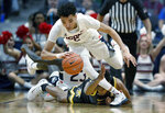 Connecticut's James Bouknight, top, grabs a loose ball leaving Wichita State's Grant Sherfield, bottom, behind in the second half of an NCAA college basketball game, Sunday, Jan. 12, 2020, in Hartford, Conn. (AP Photo/Jessica Hill)