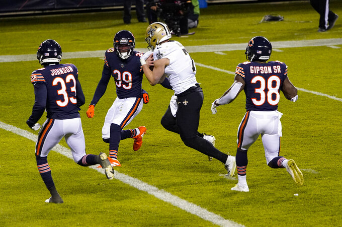 New Orleans Saints quarterback Taysom Hill (7) runs in for a touchdown between Chicago Bears cornerback Jaylon Johnson (33) and free safety Eddie Jackson (39) in the second half of an NFL football game in Chicago, Sunday, Nov. 1, 2020. (AP Photo/Charles Rex Arbogast)