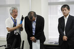 Yutaka Katada, center, president of Kokuka Sangyo Co., the Japanese company operating one of two oil tankers attacked near the Strait of Hormuz, bows after talking to reporters at a news conference Friday, June 14, 2019, in Tokyo. Iran rejects a U.S. accusation against Tehran over suspected attacks on two oil tankers near the strategic Strait of Hormuz. (AP Photo/Jae C. Hong)