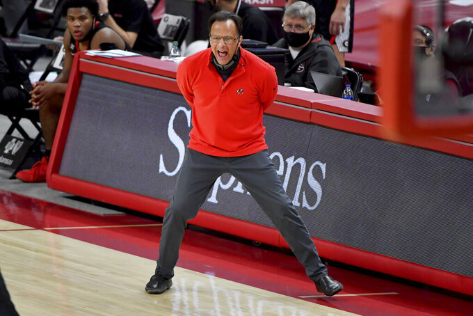 Georgia coach Tom Crean talks to his team as they play Arkansas during the second half of an NCAA college basketball game Saturday, Jan. 9, 2021, in Fayetteville, Ark. (AP Photo/Michael Woods)