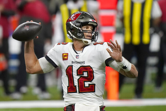 Tampa Bay Buccaneers quarterback Tom Brady (12) works against the New Orleans Saints during the first half of an NFL divisional round playoff football game, Sunday, Jan. 17, 2021, in New Orleans. (AP Photo/Brynn Anderson)