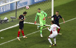 Croatia's Sime Vrsaljko, left, heads the ball away from the goal during the semifinal match between Croatia and England at the 2018 soccer World Cup in the Luzhniki Stadium in Moscow, Russia, Wednesday, July 11, 2018. (AP Photo/Thanassis Stavrakis)