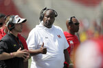 Maryland head coach Michael Locksley gestures toward running back Lorenzo Harrison III during the second half of an NCAA college football game against Howard, Saturday, Aug. 31, 2019, in College Park, Md. Maryland won 79-0. (AP Photo/Julio Cortez)