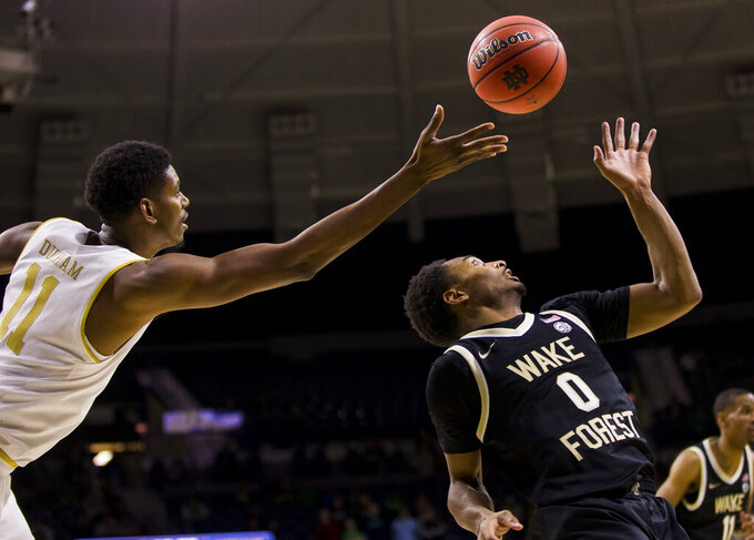 Notre Dame's Juwan Durham (11) and Wake Forest's Brandon Childress (0) compete for a rebound during the second half of an NCAA college basketball game Wednesday, Jan. 29, 2020, in South Bend, Ind. Notre Dame won 90-80. (AP Photo/Robert Franklin)
