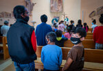 """Residents attend a mass inside a church located in the Roma settlement at the Lunik IX quarter of Slovakia's second largest city of Kosice, Sunday, Sept. 5, 2021. Pope Francis will make his visit to the impoverished Roma community in Slovakia one of the highlights of his pilgrimage to """"the heart of Europe."""" Francis will be the first pontiff to meet the most socially excluded minority group in that Central European country. (AP Photo/Peter Lazar)"""