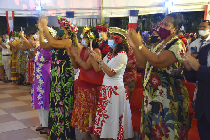 French Polynesians dressed in traditional clothes applause France's President Emmanuel Macron during his speech in Tahiti, French Polynesia in the Pacific Ocean, Tuesday, 27, 2021.President Emmanuel Macron reasserted France's presence in the Pacific on a visit to French Polynesia aimed in part at countering growing Chinese dominance in the region. (AP Photo/Esther Cuneo)