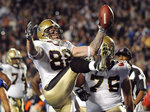 FILE - In this Feb. 7, 2010, file photo, New Orleans Saints tight end Jeremy Shockey (88) reacts after his 2-yard touchdown pass reception against the Indianapolis Colts during the second half of the NFL Super Bowl XLIV football game, in Miami. As part of its celebration of its 100th season, the NFL is designating a Game of the Week, each chosen to highlight a classic matchup. For this week, it is the Colts-Saints game. (AP Photo/Mark J. Terrill, File)