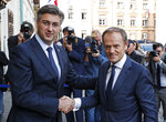 President of the European Council Donald Tusk, right, is welcomed by Croatia's prime minister Andrej Plenkovic in Zagreb, Croatia, Tuesday, Nov. 19, 2019. Donald Tusk attends the European Peoples Party (EPP) congress in Zagreb. (AP Photo/Darko Bandic)