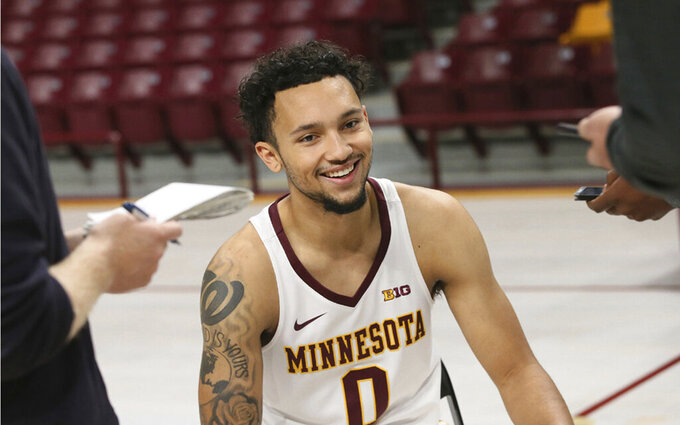 In this Oct. 28, 2019 photo, former Vanderbilt guard Payton Willis talks with reporters during Minnesota's NCAA college basketball media day in Minneapolis. Willis is one of three transfers to Minnesota eligible to play this season as Minnesota must replace its two best players in Jordan Murphy and Amir Coffey. (AP Photo/Jim Mone)