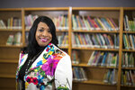 This Wednesday, April 18, 2018 photo shows Carlotta Outley Brown, who was then the principal at Peck Elementary School located in southeast Houston. Outley Brown took over as principal at James Madison High School during the current school year, becoming the school's fourth principal in five years. Outley Brown has implemented a dress code for parents because she says it is necessary to establish high standards for students, despite criticism that the move could be discriminatory. (Marie D. De Jesus/Houston Chronicle via AP)