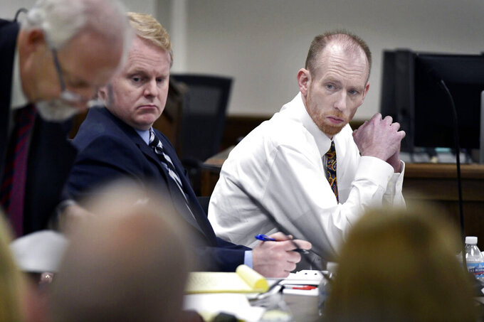 Chad Isaak, right, of Washburn, sits with his defense team during the third day of his murder trial at the Morton County Courthouse in Mandan, N.D., on Wednesday, Aug. 4, 2021. Isaak is on trial for the killings of four people at RJR Maintenance and Management in Mandan on April 1, 2019. (Mike McCleary/The Bismarck Tribune via AP)