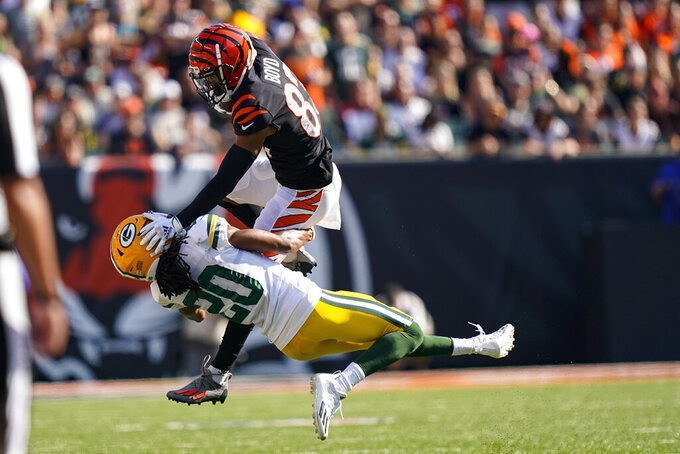 Cincinnati Bengals wide receiver Tyler Boyd (83) is tackled after a catch over Green Bay Packers cornerback Kevin King (20) in the second half of an NFL football game in Cincinnati, Sunday, Oct. 10, 2021. (AP Photo/Bryan Woolston)