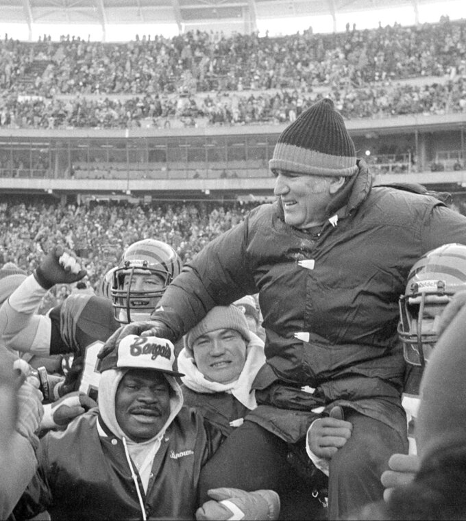FILE - In this Jan. 10, 1982, file photo, Cincinnati Bengals coach Forrest Gregg is carried off the field by players and fans after the Bengals defeated the San Diego Chargers in the AFC Championship playoff game in Cincinnati, Ohio. The Pro Football Hall of Fame says Forrest Gregg has died. He was 85. The Hall did not disclose details about his death in its statement Friday, April 12, 2019. (AP Photo/File)