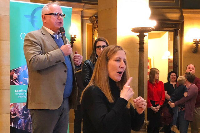 Minnesota Gov. Tim Walz urges Minnesota lawmakers on Friday, Feb. 14, 2020, in Minneapolis, to pass a ban on